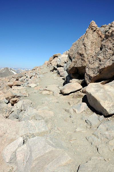 It is a 10-minute hike on a rocky trail to the official summit (14,264 ft).
