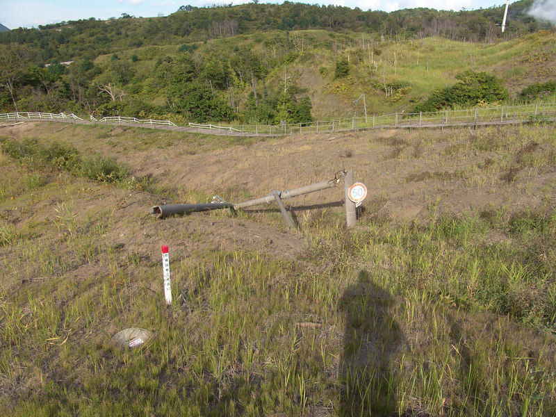 A visual reminder of the power released during the inital eruption. These are metal utility poles snapped off during the blast.