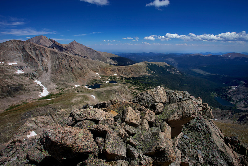 The summit of Mt. Alice at at 13,310ft (4057 m) looking across at Chiefs Head Peak and Longs Peak  and down upon the Wild Basin.