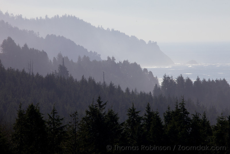 Mountain ridges stretch down to the ocean along the Oregon Coast.