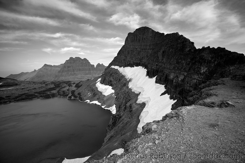 From the Sue Lake overlook above Fifty Mountain, one can see the sharp edge of Mount Kipp above Sue Lake and Mount Merritt in Glacier National Park, Montana.
