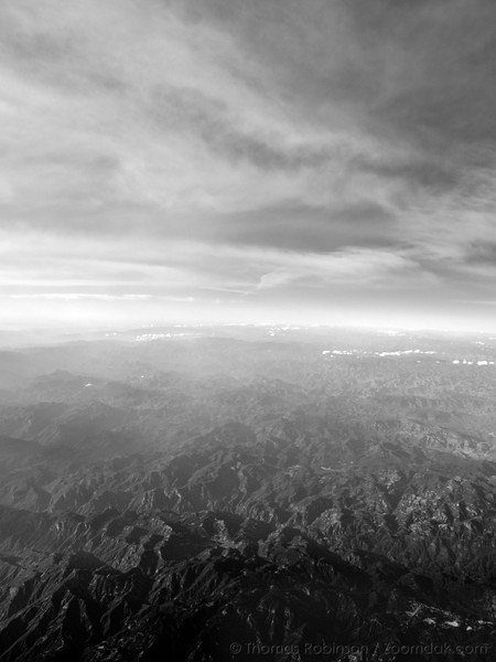 Mountains of the Baja Peninsula stretch into the distance - as seen from the air.