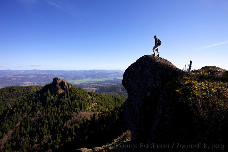Garrett Young stands atop Angora Peak and gazes out over the Coastal Range stretched below. Up logging roads and a bit off trail, Angora Peak is a great day hike on the Oregon Coast.