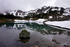 Clouds gather around Mount Fricaba with the reflection upon Imperial Tarn in the upper Royal Basin in the Olympic National Park.