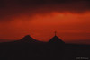 Cerro Pedernal and Truchas steeple. The color of the sky is the result of several major forest fires.