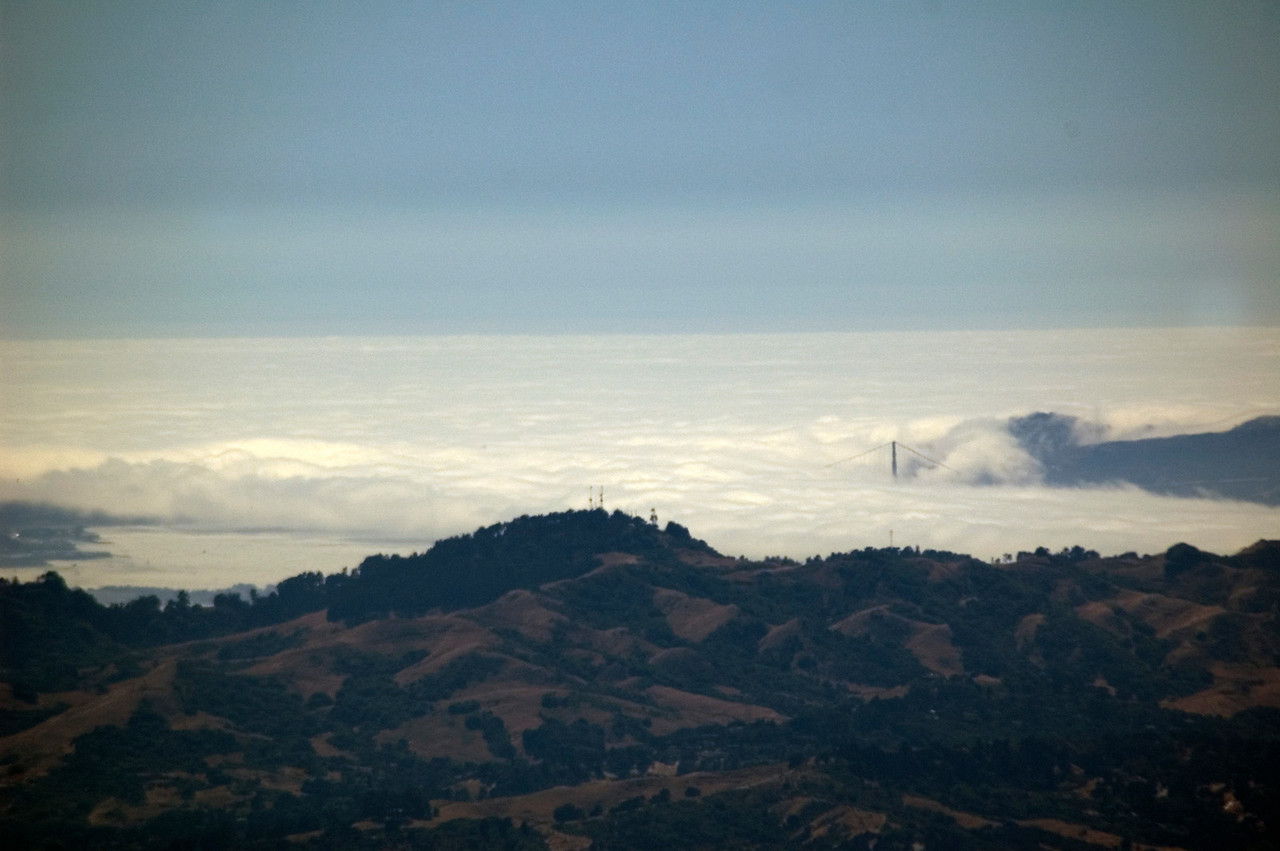 Taken from the summit. The Golden Gate Bridge peaks from the fog on the right. Downtown can be seen on the extreme left.