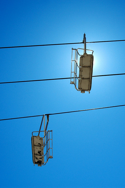 Skilift chairs baking in the summer sun.