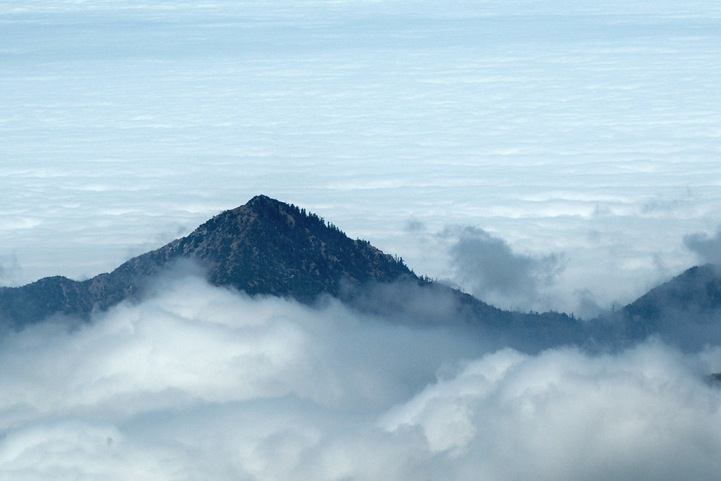 Closeup of a mountain in the clouds.