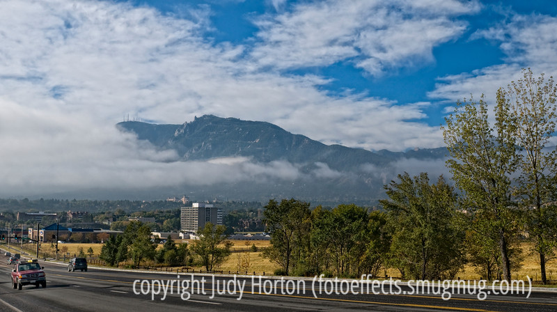 The fog hangs across part of Cheyenne Mt. in Colorado Springs, but you can see the many communication towers on the flank of the mountain.