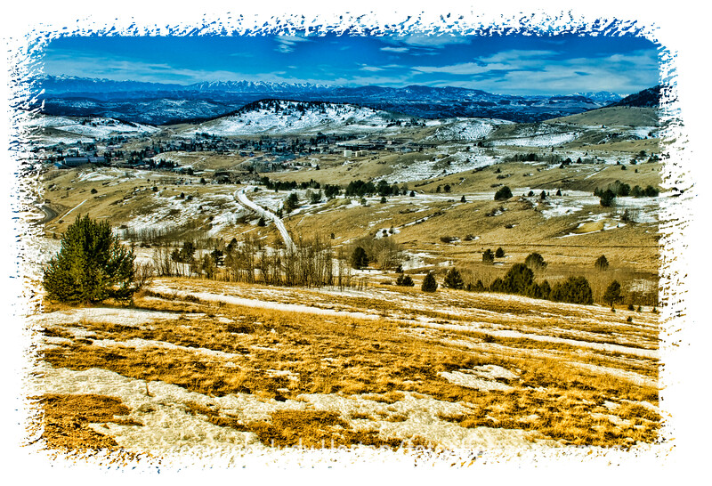 A view looking down the mountain looking toward Cripple Creek, Colorado.  Detail in this image is best viewed in a larger size.