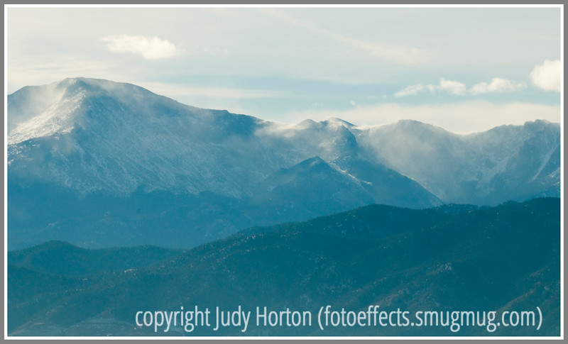 Blowing snow on one flank of Pike's Peak obscures the outlines of the mountain.
