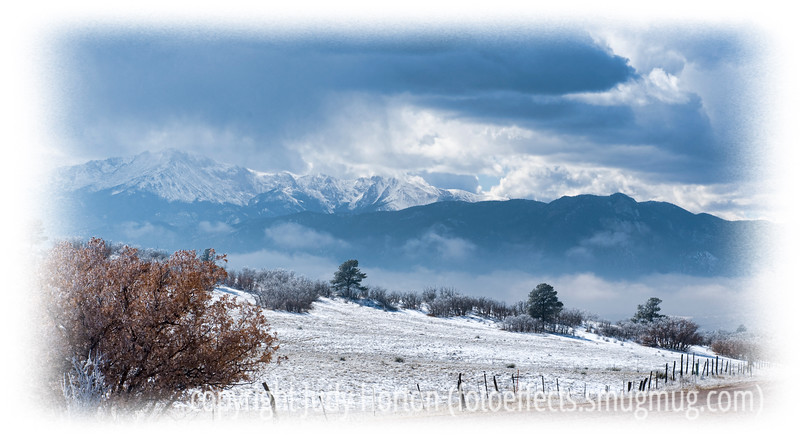 Low hanging clouds lie on Pike's Peak and across the Front Range in Colorado Springs