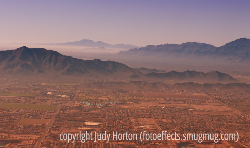 View of Phoenix, AZ as the plane is approaching the runway on landing.