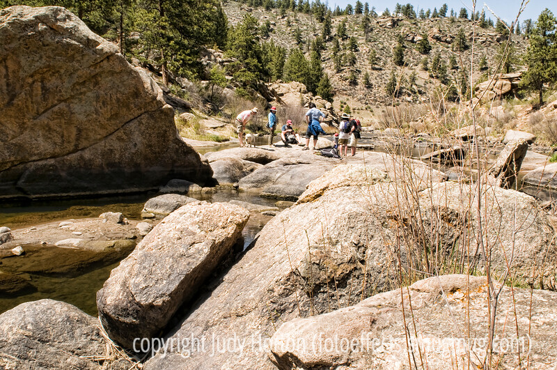 A family group enjoys the boulders and rapids on the S. Platte River in Eleven Mile Canyon in Colorado.