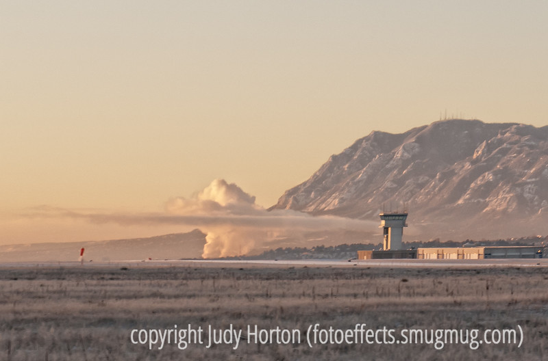 Air Force Academy tower and the steam from the Colorado Springs utility plant
