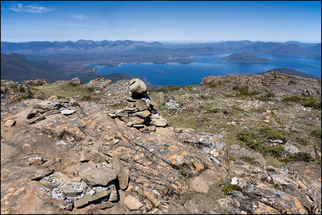 Cairn at summit of Eliza.Lake Pedder in background