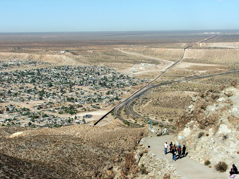 Sunland Park NM on the right, Anapra colonia Chihuahua Mexico on the left, and the newly constructed 10ft tall border fence between them going into the distance.