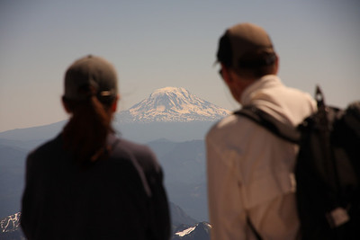 Two climbers observing Mt. Adams form Camp Muir - Mt. Rainier