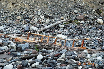 A handmade bridge crossing a creek at the foot of Mt. Ranier.