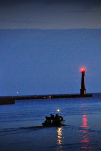 Looking out Muskegon Lake Channel toward south pier lighthouse and Lake Michigan