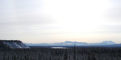 Looking southeast from the Tok Cut-Off.  From left to right: The bluff over Ahtell Creek where it joins the Slana River, the Copper River floodplain, white with fresh-fallen snow, Tanada Ridge, Mt. Blackburn.