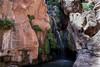 Grand Canyon 31<br /> Elves Chasm is approx. 117 miles from Lee's Ferry. This is a short hike from the river up a canyon. You can go under the falls and up a short climb to come out half way up and jump into the pool below.