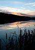 BLAINE FALKENA/Hazleton Standard-Speaker<br /> The sun sets lighting up the clouds over Lake Marie in Beaver Park, Beaver Meadows Sunday evening.