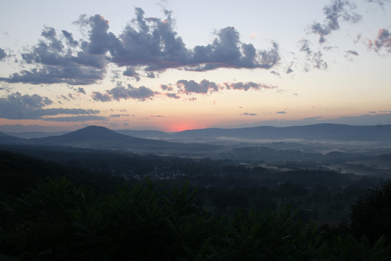 BLAINE FALKENA - The sun sinks slowly over the Conyngham Valley as fog settles in during the evening of August 17th, 2007.