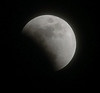 BLAINE FALKENA/Staff Photographer<br /> The moon is partially eclipsed by the earth at 9:04 Wednesday night.