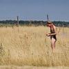 Teenage girl in field making flower wreaths - Golden hair in a golden field