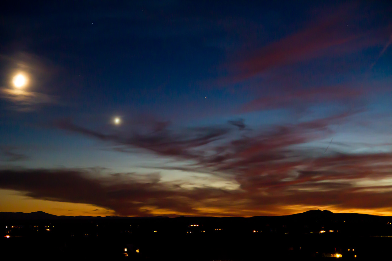 The sunsets over Taos, New Mexico. Someone told me that the planet to the right of the moon was Jupiter, but I'm not certain.