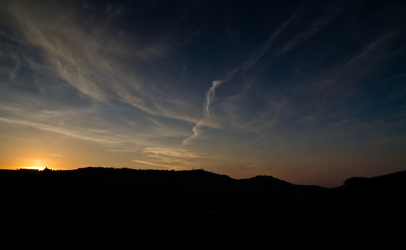 Langhe sunset. In the center of the picture is the silhouette of the hills near La Morra commune
