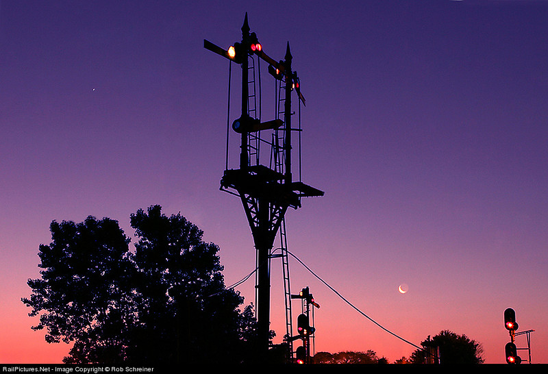 Sunrises on the signal tower at Brighton Park, cresent moon hangs low.  The semaphores are all gone now.