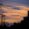"Beautiful summer evening sky... in Japan (emphasize ""cables everywhere"")."