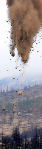 Mulch falling from the sky during Boulder County air mulch operation for the Fourmile Fire restoration.