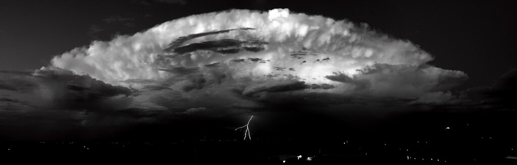A view from Legion Park located west of Boulder Colorado.  This thunderhead east of Boulder County let out a single strike as it moved eastward over the plains.