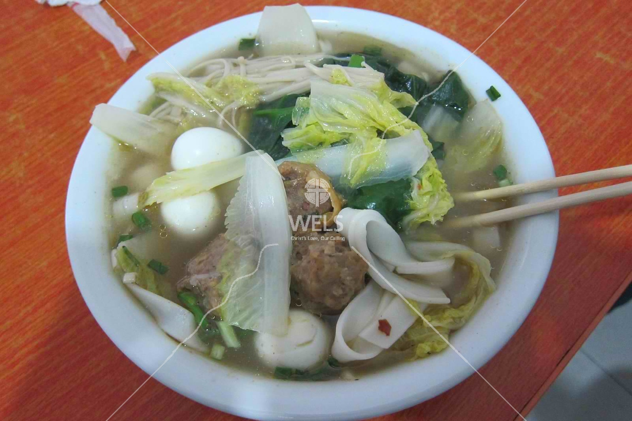 Fresh noodle soup with mushrooms, quail eggs, Wenling China  by kstellick