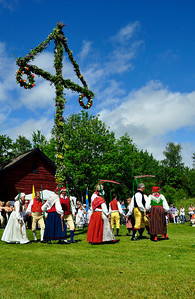 Midsummer day in Sweden. Harwest dance round the Midsummer tree. Folklore ensemble of Sweden in traditional folk costume at midsummer  day 19 June 2009.