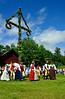 Midsummer day in Sweden. Harwest dance round the Midsummer tree.<br /> Folklore ensemble of Sweden in traditional folk costume at midsummer <br /> day 19 June 2009.