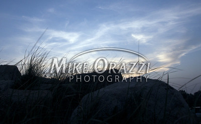 The sun setting at East Beach in Charlestown, Rhode Island. ©MikeOrazzi
