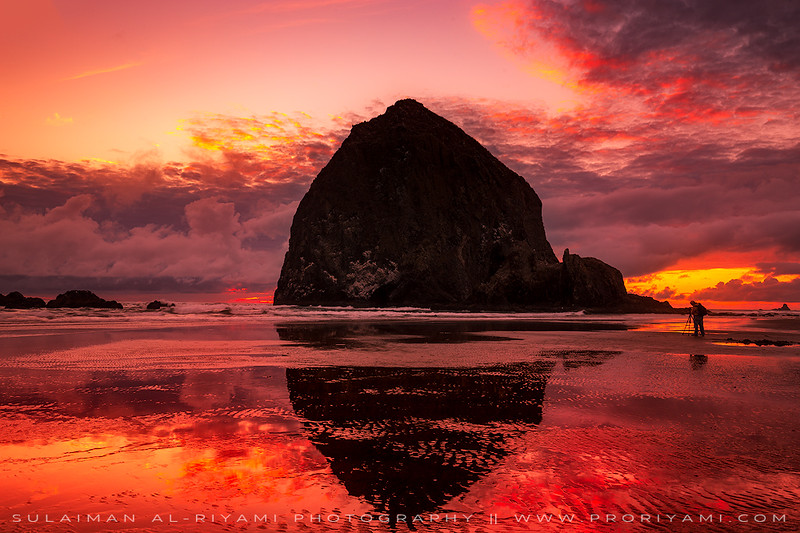 photographer in action, Cannon beach, Oregon coast, USA