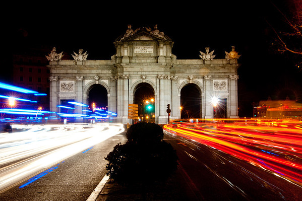 Independence Plaza Madrid Puerta de Alcala at night with car lights