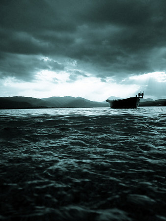 A little boat awaiting the storm ahead.  Poros, Greece