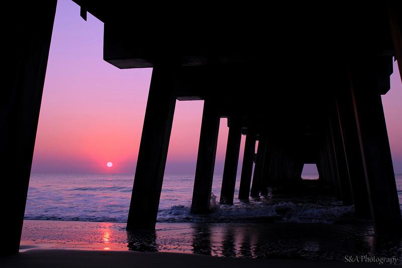 Sunrise on pier at Tybee Island, GA.