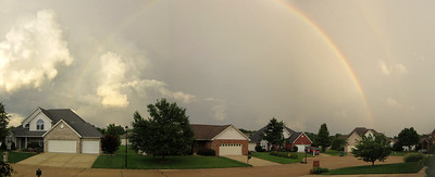 Full rainbow with clouds