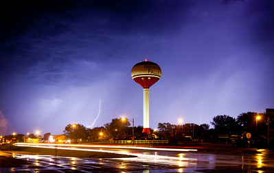 Lightning behind Redwood Falls water tower