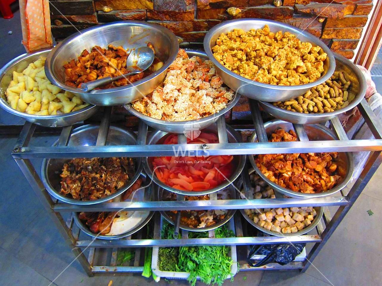 Restaurant kitchen, needed cooking items,  SE coastal village China by kstellick