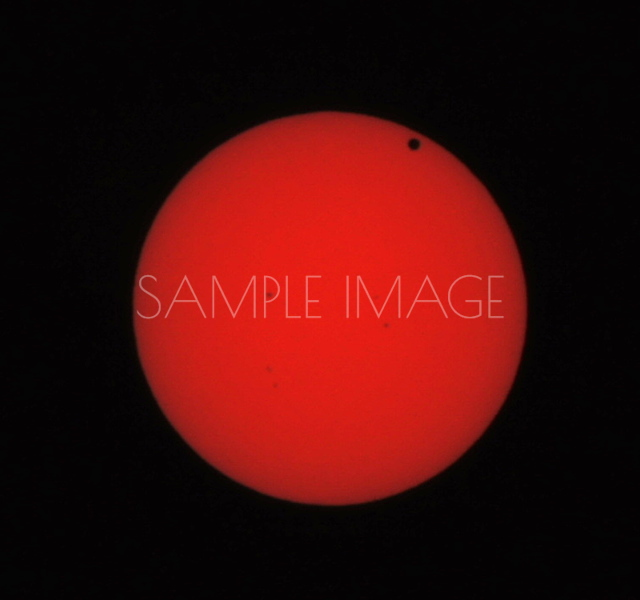 Venus Eclipse - This image was taken by Sony Alpha 55A with a 250mm lens, hand held, using Infra Red filter. The dark spots in the sun are actually Sun Spots and not a dirty lens. You can see the same spots in other images taken by the Nikon D800.