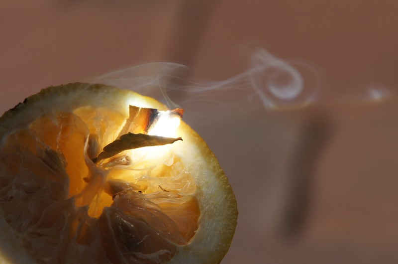 Focusing the sunlight through a magnifying glass onto a Lemon... The smoke gets some interesting shapes. An experiment with my 10 years old son.