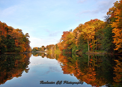 Fall trees reflect upon Eastman Lake in Durand Eastman Park...Rochester, NY